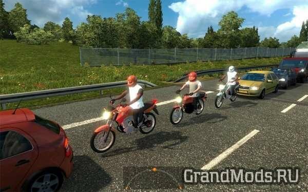 Bikers in traffic